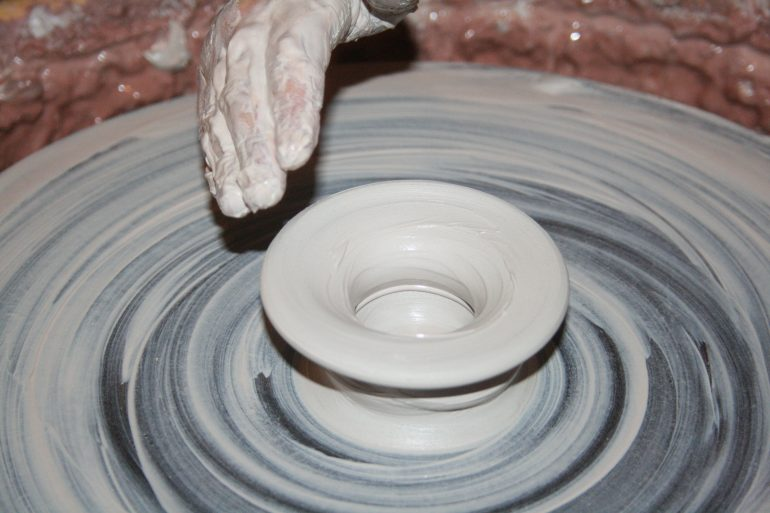 person-making-clay-pot-162574